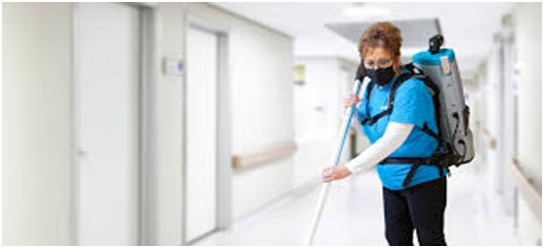 Commercial cleaning services by aimpests team member